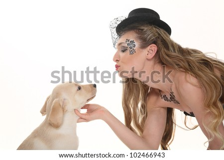 beautiful woman with puppy labrador - stock photo