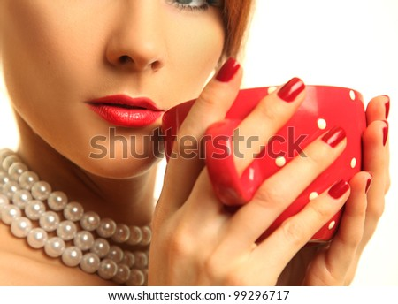 beautiful woman with red cup - stock photo