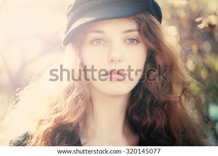 Beautiful Woman with Red Curly Hair Outdoors - stock photo
