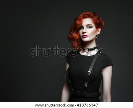 beautiful woman with red hair in a black dress - stock photo