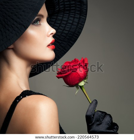 Beautiful Woman With Red Rose. Retro Fashion Image. - stock photo
