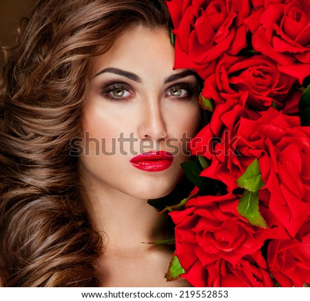 beautiful woman with red roses - stock photo