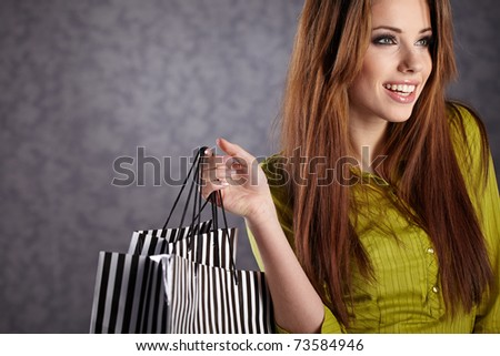 Beautiful woman with shopping bags - stock photo