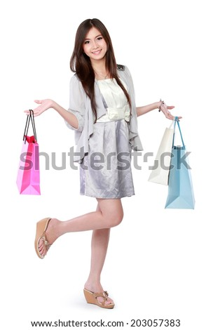 Beautiful woman with shopping bags over white background - stock photo