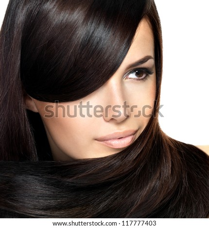 Beautiful woman with straight hair. Closeup portrait of a fashion model posing at studio. - stock photo
