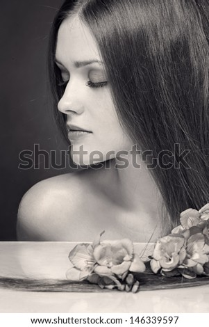 Beautiful Woman with Straight Long Hair.  Black and white background - stock photo