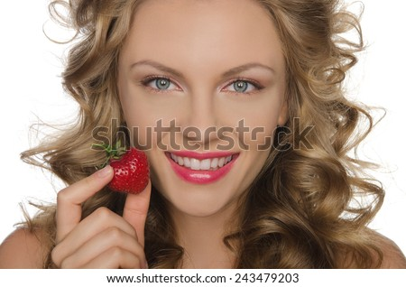 Beautiful woman with strawberries in hands isolated on white - stock photo