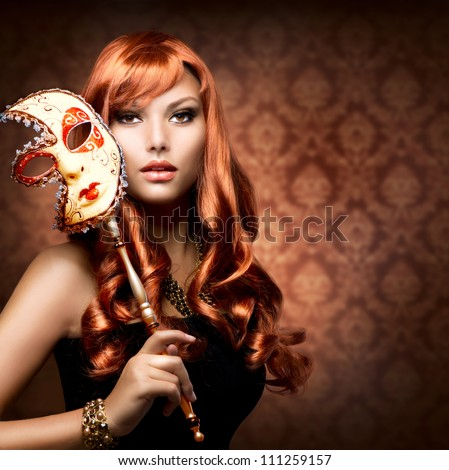Beautiful Woman with the Carnival mask. - stock photo