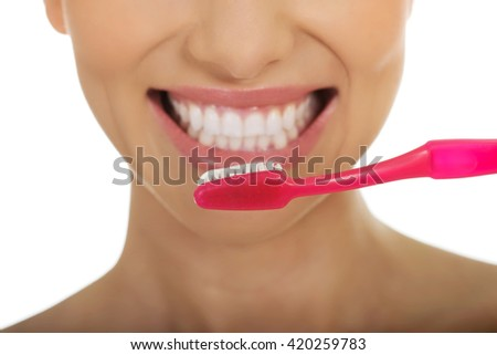 Beautiful woman with toothbrush. - stock photo