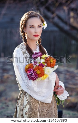 beautiful woman with traditional costume - stock photo