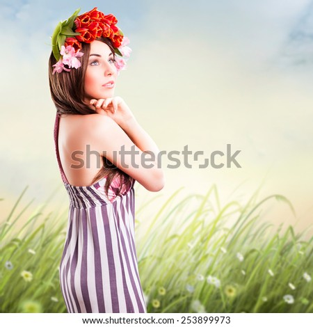 beautiful woman with tulip hair decoration - stock photo
