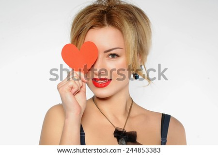 Beautiful woman with valentine's day card - stock photo