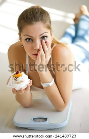 Beautiful woman with weights and food - stock photo