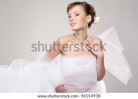 Beautiful woman wrapped in fabric - stock photo