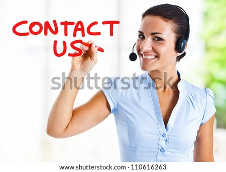 Beautiful woman writing Contact - stock photo
