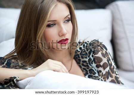 Beautiful woman. Young pretty woman with beautiful long hairs and red lips - stock photo