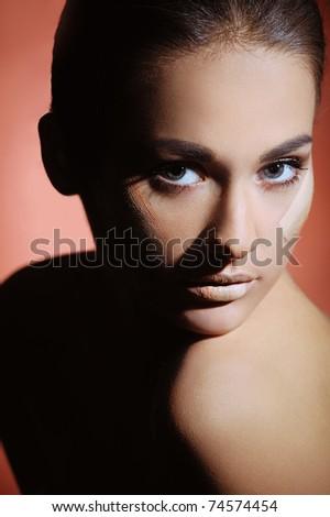 Beautiful women applying female makeup cream - stock photo
