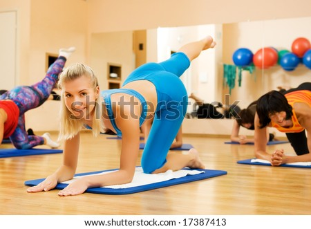 Beautiful women exercising in fitness club - stock photo