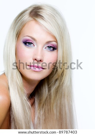 Beautiful women face with fashion makeup and straight long hair - stock photo