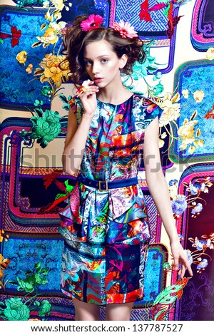Beautiful women, flowers hairstyle, posing  on  summer fairy tale pattern background - stock photo