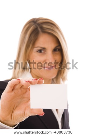 Beautiful women holding her business card (focus on the hand) - stock photo
