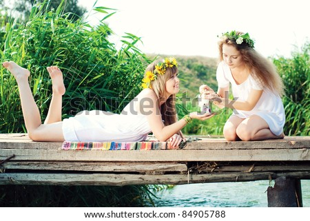Beautiful women in the countryside - stock photo