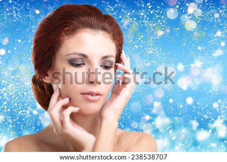 Beautiful Women over winter Christmas background.Spa - stock photo