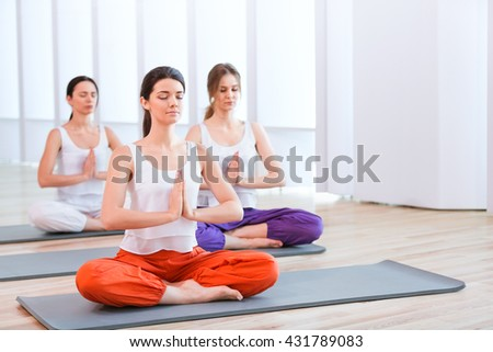 Beautiful women practicing yoga - stock photo