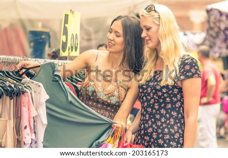 beautiful women shopping together at the city mall - stock photo