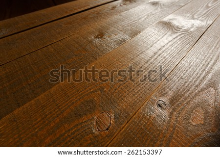 Beautiful wooden background, brown, backlit with shallow depth of field - stock photo