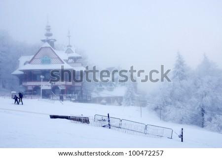 Beautiful wooden cabin in Czech republic, winter - stock photo