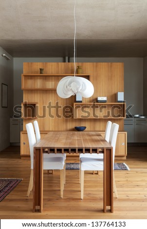 beautiful wooden dining table,  interior of a chalet - stock photo