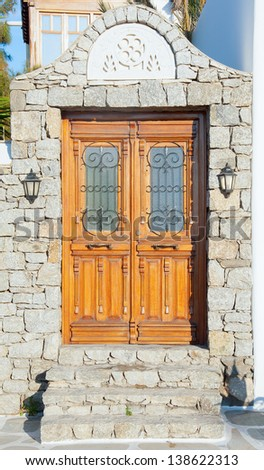 Beautiful wooden door in the garden - stock photo
