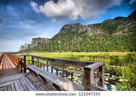 Beautiful wooden gazebo over the lake - stock photo