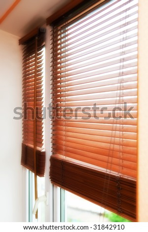 Beautiful wooden jalousie at a window - stock photo