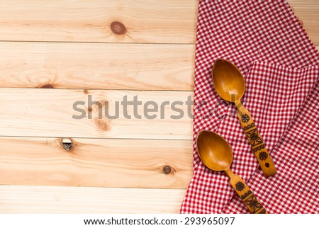 beautiful wooden spoons lie in the ethnic style on a napkin made of cloth on a wooden table. background - stock photo