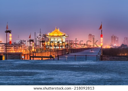 beautiful xian city wall and ancient tower in nightfall ,China  - stock photo