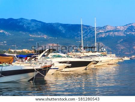 Beautiful yacht on the shore of the city of Budva Montenegro - stock photo
