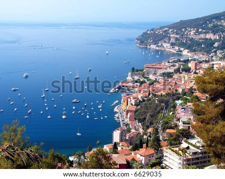 Beautiful yachts in the light-blue sea. - stock photo