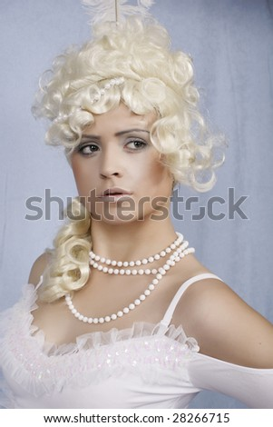 Beautiful yang queen on blue in white wig - stock photo