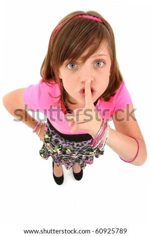 Beautiful 10 year old girl making hush gesture looking up at camera. Top view over white background. - stock photo