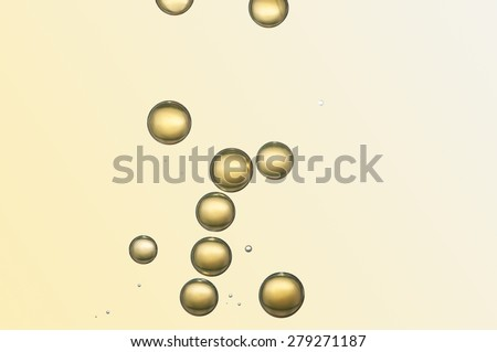 Beautiful yellow champagne bubbles flowing - stock photo