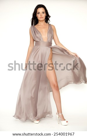 Beautiful young adult slim sexy and attractive sensuality pretty brunette woman in brown elegance dress isolated on white background - stock photo