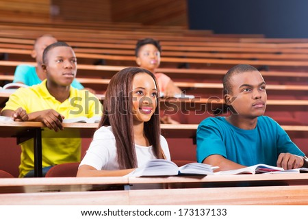 beautiful young african American college students in lecturing hall - stock photo