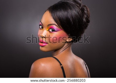 beautiful young african american girl looking back her shoulder - stock photo