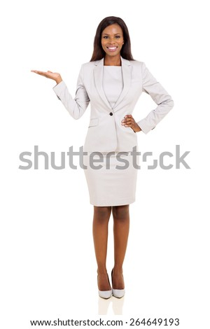 beautiful young african businesswoman presenting on white background - stock photo