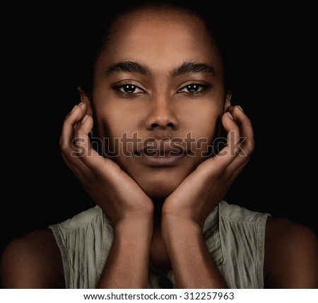 Beautiful Young Afro American Woman on Black - stock photo