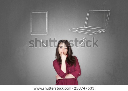 Beautiful young and pretty woman taking a decision (choose) between tablet and notebook (laptop) - stock photo