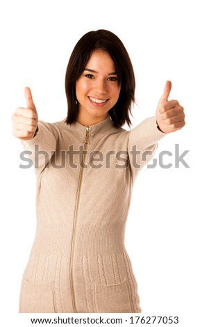 Beautiful young asian caucasian woman in sweater showing thumb up isolated over white background - stock photo