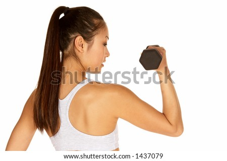 Beautiful Young Asian in Sports Bra with Dumbbell - stock photo